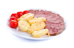 Roastbeef with potatoes. And cherry tomatoes  on white Royalty Free Stock Photo