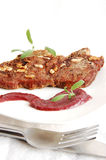 Roastbeef with red wine sauce. Soft roastbeef with garlic and salvia, decorated with red wine sauce Stock Photography