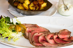 Roastbeef in a restaurant. On the plate Royalty Free Stock Photography