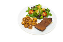 Roastbeef Scheibe, Pilze und Salat Stockfotos