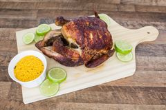 Roaste chicken with farofa and lemon