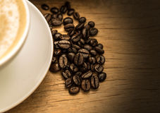 Roaste coffee   beans  On the  old background Stock Photography