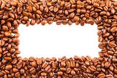 Roasted布朗咖啡豆框架或边界关闭与警察 免版税库存照片