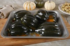 Roasted acorn squash in a baking pan stock photography