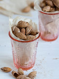 Roasted almonds. In the shell in a glass Royalty Free Stock Images