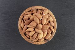 Roasted almonds in bowl on slate background Stock Photography