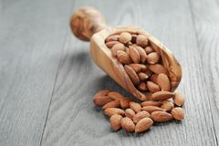Roasted almonds on gray wooden table Stock Images