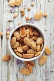 Roasted almonds with rosemary and sea salt, top view Royalty Free Stock Photo