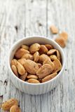 Roasted almonds with rosemary and sea salt in a white bowl Stock Images