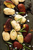 Roasted almonds with salt and rosemary Stock Images