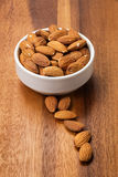 Roasted almonds in white porcelain bowl Stock Image