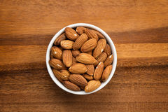 Roasted almonds in white porcelain bowl Stock Photography
