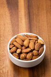 Roasted almonds in white porcelain bowl Royalty Free Stock Photography