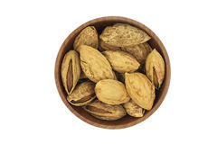 Roasted almonds in a wooden bowl Royalty Free Stock Photos
