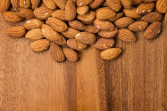 Roasted almonds on wooden table Royalty Free Stock Image