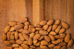 Roasted almonds on wooden table Stock Image