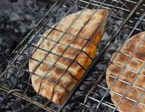 Roasted arabic bread pita on the grill closeup Royalty Free Stock Photos