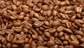 Roasted Arabica coffee beans background high angle. Roasted brown Arabica coffee big beans background pattern, close up, high angle view Royalty Free Stock Image
