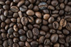 Roasted arabica coffee beans background. Roasted arabica coffee beans texture background macro Royalty Free Stock Photography