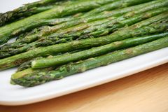 Roasted Asparagus. On a White Plate Stock Photos