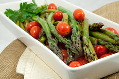 Roasted Asparagus And Cherry Tomatoes. On A White Serving Dish Stock Photo