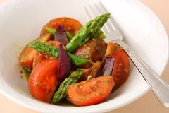 Roasted Asparagus And Cherry Tomatoes Royalty Free Stock Photography