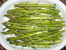 Roasted Asparagus. Sprinkled with fresh chives is shown Stock Photography