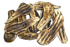 Roasted Aubergine. Slices of roasted aubergine isolated over a white background stock images