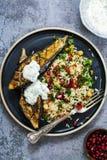 Roasted aubergine with jeweled rice. Roast aubergine with Persian jeweled rice Royalty Free Stock Images