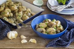 Roasted baby potato salad with creamy garlic dressing royalty free stock images