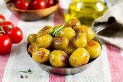 Roasted baby potatoes with rosemary Stock Photos