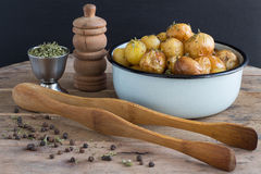 Roasted Baby Potatoes with Savory and Black Pepper. Bowl of Roasted Baby Potates with Savory and Black Pepper Stock Photos