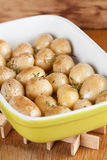 Roasted baby potatoes with thyme. Olive oil and salt on baking sheet Royalty Free Stock Image