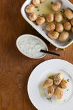 Roasted baby potatoes with thyme. Olive oil and salt with tzatziki Stock Photos