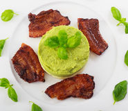 Roasted bacon on  white plate. Roasted bacon on white plate,served with potato and broccoli puree Royalty Free Stock Photos