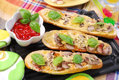 Roasted baguette with cheese and mushrooms Stock Photos