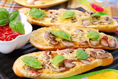 Roasted baguette with cheese and mushrooms Royalty Free Stock Photos