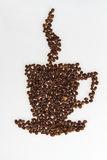 Roasted beans gathered in a shape of coffee cup Stock Image