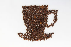 Roasted beans gathered in a shape of coffee cup Stock Photo