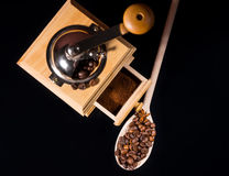 Roasted beans near a vintage manual coffee grinder Royalty Free Stock Photography