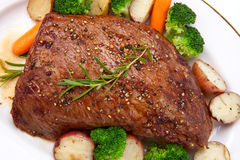 Roasted Beef. Loin tri-tip, garnished with vegetables Stock Images