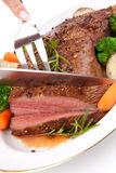 Roasted Beef. Loin tri-tip, garnished with vegetables Royalty Free Stock Photography