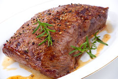Roasted Beef. Loin tri-tip with ground pepper Stock Photo