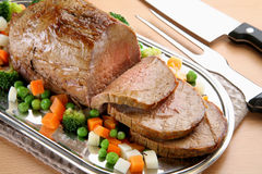 Roasted Beef. On tray, cutted, with fresh vegetables Stock Photo