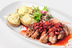 Roasted beef with berry and apple sauce royalty free stock photography