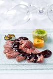 Roasted beef with black currant sauce Stock Images