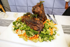 Roasted beef with boil vegetables. On dinner buffet stock image