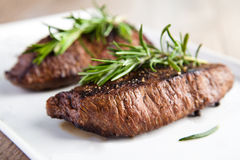 Roasted beef fillet with rosemary Stock Image