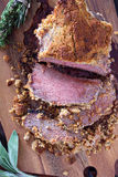 Roasted beef with herbed bread crust Royalty Free Stock Photo