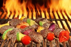 Roasted Beef Kebabs With Vegetables On BBQ Flaming Grill Royalty Free Stock Images